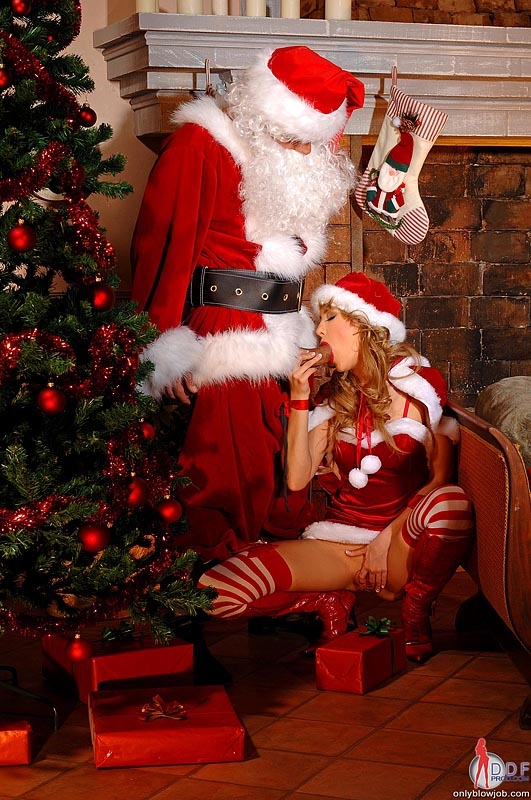 Mrs clause giving santa his present 7