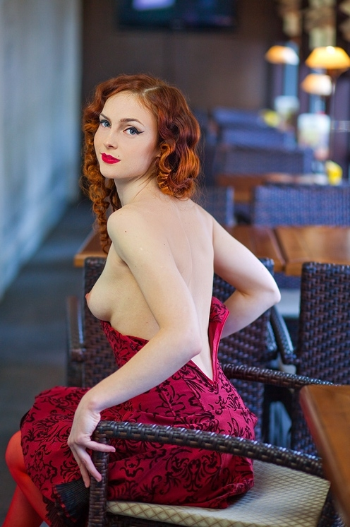 Redhead wearing a red dress.; Red Head Small Tits